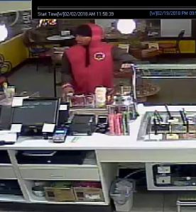 Subject in red hoodie at counter